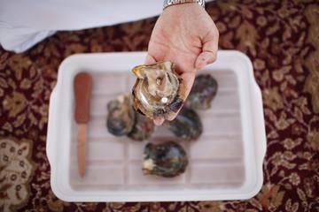 A man displays a pearl at RAK's oyster farm off the coast of Ras Al Kaimah