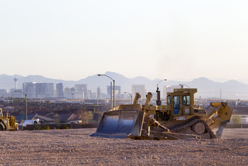 Las Vegas Strip casinos are seen in the background as earth movers prepare the desert for new homes at the Mountain's Edge master planned community in the southwest west part of the Las Vegas Valley