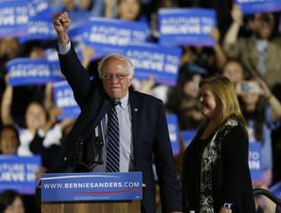 Democratic U.S. presidential candidate Bernie Sanders and wife Jane take the stage in Santa Monica
