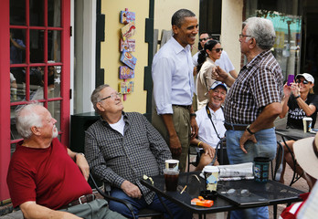 U.S. President Barack Obama meets with customers outside restaurant while campaigning in Florida