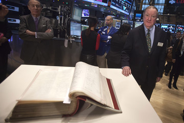 Cashin poses for a photo with the New York Stock Exchange Constitution book in New York