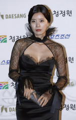 South Korean actress Yoosun poses for photographs before the Blue Dragon Film Awards in Seoul