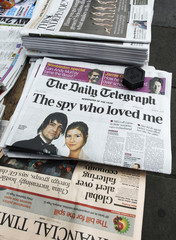 Daily Telegraph newspaper, featuring a front page interview with the ex-husband of accused Russian spy Anna Chapman, is seen at a kiosk in London