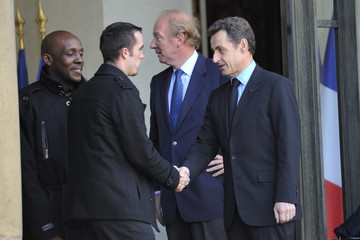 France's President Sarkozy accompanies Tremblay-en-France bus drivers after a meeting at the Elysee palace in Paris