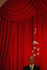 Myanmar's President Thein Sein waits for a signing ceremony during his visit to the Istana in Singapore