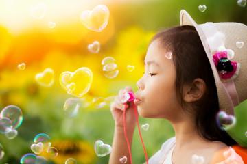 Asian kid play bubble