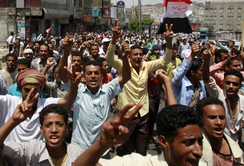 Anti-government protesters shout slogans during a demonstration demanding the ouster of Yemen's President Ali Abdullah Saleh in the southern city of Taiz