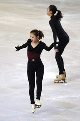 Fumie Suguri and Mao Asada practice during a training session before the Bompard Trophy event at Bercy in Paris