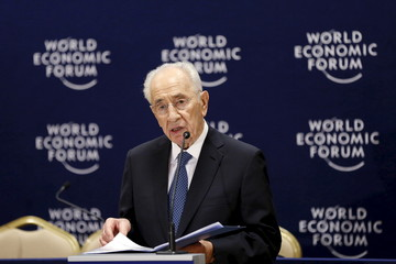 Former Israeli President Shimon Peres speaks during a news conference at the World Economic Forum on the Middle East and North Africa at the King Hussein Convention Centre at the Dead Sea