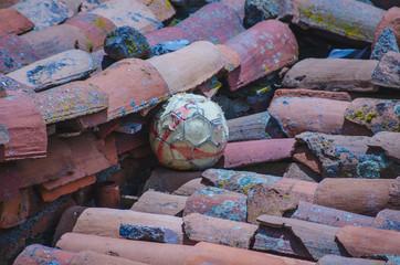 Soccer ball on a tiled roof
