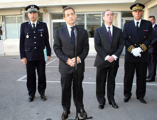 France's President Sarkozy addresses the media outside police headquarters in Marseille