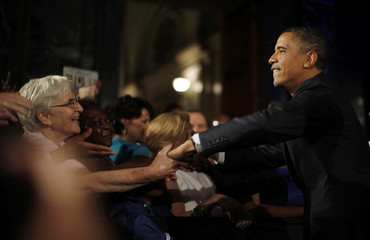 U.S. President Barack Obama greets the crowd at a Democratic Party fundraising event in Chicago