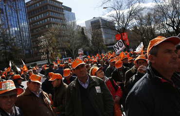 Farmers and stockbreeders attend a protest against cuts in their sectors, outside the headquarters of the European Union in Madrid
