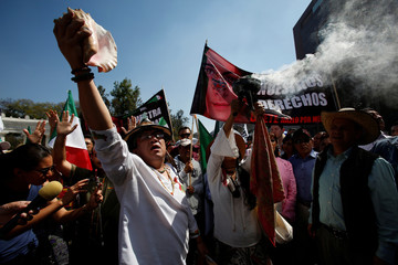 Demonstrators perform a pre-Hispanic ritual during a protest against U.S. President Donald Trump's proposed border wall, and to call for unity, in Mexico City, Mexico