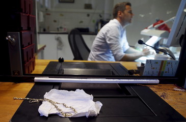 A gold necklace left by a client in exchange for a loan is pictured at the Mont de Piete in central Brussels
