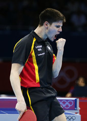 Germany's Dimitrij Ovtcharov celebrates a point against Denmark's Michael Maze in their men's singles quarterfinals table tennis match at the ExCel venue during the London 2012 Olympic Games