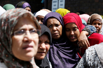 Mourners react after the funeral of Abdirahman Abdi in Ottawa