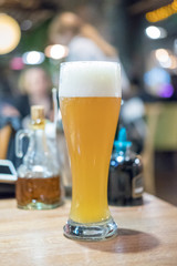 Glass of beer with blur background