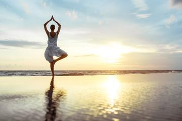 In de dag Ontspanning Yoga on the beach