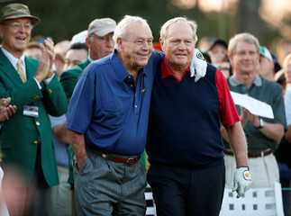 U.S. golfing great Nicklaus gets a hug from Palmer while participating in the honorary starters ceremony before the start of the 2015 Masters golf tournament at Augusta National Golf Course in Augusta