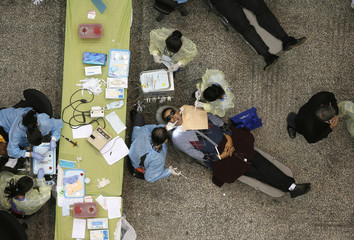 People receive dental treatment at Care Harbor LA free medical clinic in Los Angeles