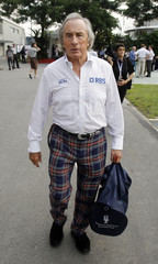 Former Formula One world champion Jackie Stewart arrives for the third practice session of the Singapore Grand Prix at the Marina Bay circuit