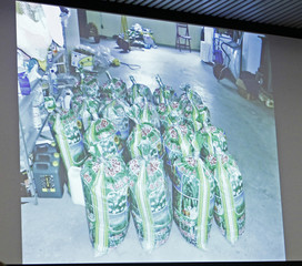 A projection screen displays pictures of equipment and materials used by Norwegian mass killer Breivik, on the opening day of proceedings against Breivik, in Oslo