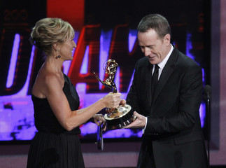 Bryan Cranston accepts the award for outstanding lead actor in a drama series from presenter Edie Falco at the 62nd annual Primetime Emmy Awards in Los Angeles