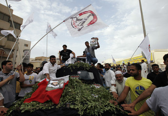 Coffin of Salah Abbas Habib is escorted by family and friends during his funeral procession in the district of al-Bilad al-Qadeem