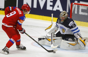 Finland's goaltender Rinne saves a penalty shoot of Russia's Panarin during their Ice Hockey World Championship game at the CEZ arena in Ostrava
