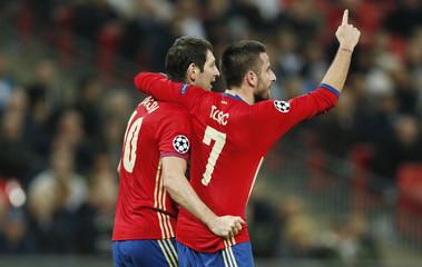 CSKA Moscow's Alan Dzagoev celebrates scoring their first goal with Zoran Tosic (R)