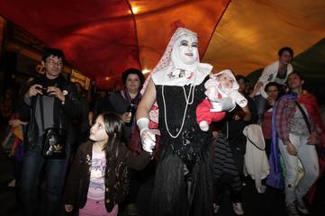 "Revellers participate in the ""Marcha de la diversidad"" in downtown Montevideo"