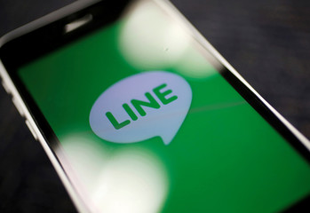 The logo of free messaging app Line is pictured on a smartphone in this photo illustration taken in Tokyo, Japan