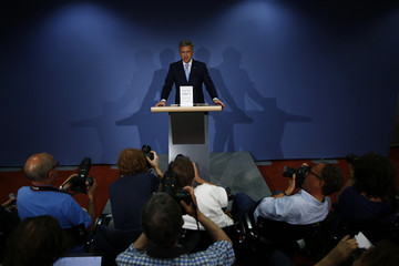 "Photographers take pictures of former German President Wulff as he presents his book ""Ganz Oben. Ganz Unten"" during news conference in Berlin"