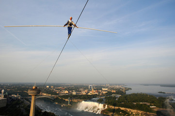 Dare-devil Jay Cochrane walks a tightrope from the Skylon Tower to the Hilton over the city of Niagara Falls, Ontario