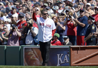 Former Boston Red Sox player Bill Buckner waves during a pre-game ceremony in Boston, Massachusetts