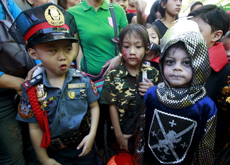 Students of Brainshire School dawn scary and colorful costumes as they participate in a halloween parade in Paranaque city, metro Manila