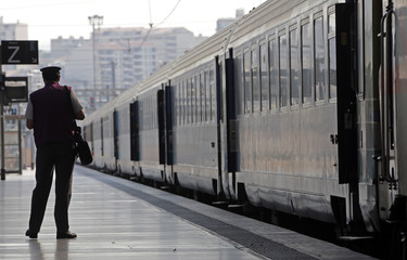 A French SNCF employee waits for the departure of a train during a nationwide strike by French SNCF railway workers at Marseille train station