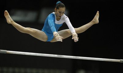 South Korea's Eum Eunhui competes on the uneven bar at the qualifying round of the Gymnastics World Championships in Rotterdam