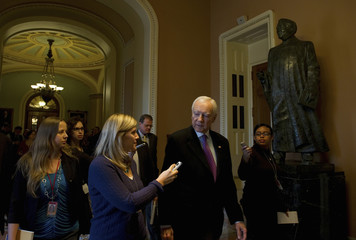 Sen. Orrin Hatch (R-UT) speaks to the media in the hall at the U.S. Capitol in Washington