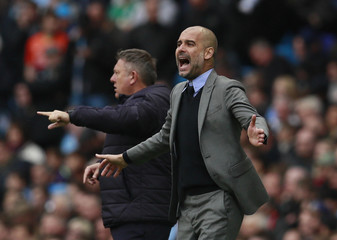 Manchester City manager Pep Guardiola and Leicester City manager Craig Shakespeare