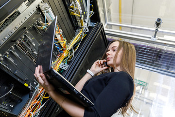 Young woman engineer at the network equipment
