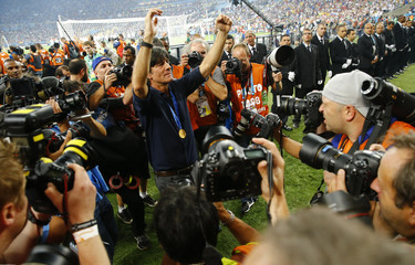 Germany's coach Joachim Loew poses for photographers after winning the 2014 World Cup final between Germany and Argentina at the Maracana stadium