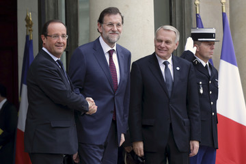 French President Francois Hollande welcome Spain's Prime Minister Mariano Rajoy at the Elysee Palace in Paris