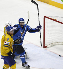 Finland's Ruutu celebrates the goal of team mate Immonen next to Sweden's Fernholm during their gold medal match at the Ice Hockey World Championships in Bratislava