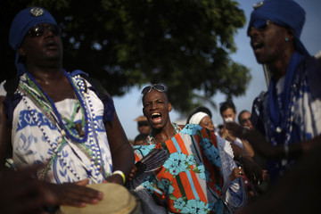 Followers of Afro-Brazilian religion Umbanda sing in tribute to Iemanja, goddess of the sea, in Copacabana Beach in Rio de Janeiro