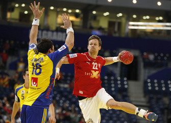 Denmark's Sondegaard Sarup triess to score as Sweden's Karlsson blocks during Men's European Handball Championship match in Belgrade