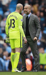 Manchester City manager Pep Guardiola celebrates after the match with Willy Caballero