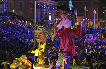 A float with giant figures of composer Ludwig van Beethoven and British musician Mick Jagger is paraded through the crowd during the Carnival parade in Nice