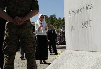 Queen Noor Al Hussein of Jordan prays during a ceremony marking the 20th anniversary of the Srebrenica massacre in Potocari